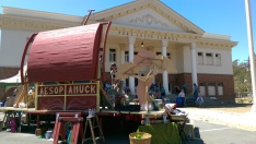 The Peripatetic Players set up their stage, FluxWagon, in front of the Port Costa School during the 2015 Bay Area tour of AESOP AMUCK.