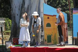 Juliet refuses the flower of Paris as Friar Lawrence looks on