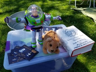 Buzz and Lion pose with some light reading