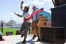 Thumper (Joan Howard) as Tybalt gets thrown out of the party thrown by Lady Capulet, played by Percival Perkins (Soren Santos) in Shakespeare or Space Wars. Photo by Serena Morelli.