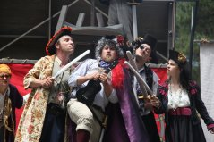 Evil Pirates aboard their evil pirate ship: Guy Hank (Paul Collins) as Captain Long Johns Danpier, Samuel Peaches (Casey Robbins) as Lord Trelawney, Meekins (Sam Bertken) as Bloody Lancaster and Princess Gwen (Marlene Yarosh) as Lady Blackhat. Photo by Soren Sa.ntos