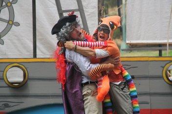 Lord Trelawney (Casey Robbins as Samuel Peaches) attacked by The Kraken (Joan Howard as Thumper). Photo by Soren Santos