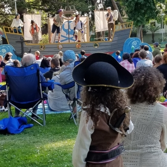 "A small pirate looks toward the Good Ship Peripatetic during ""Shiver We Timbers"" at Lincoln Park, Alameda, 2018."